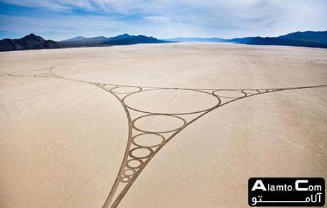هنرنمایی بر روی شن های ساحل | www.Alamto.Com